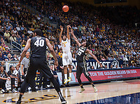 California's Tyrone Wallace shoots from outside of the arc during a game at Haas Pavilion in Berkeley, California on March 8th, 2014. California defeated Colorado 66 - 65
