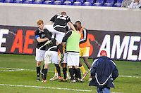 Providence Friars players celebrate at the end of the game. The Providence Friars defeated the Cincinnati Bearcats 2-1 during the semi-finals of the Big East Men's Soccer Championship at Red Bull Arena in Harrison, NJ, on November 12, 2010.