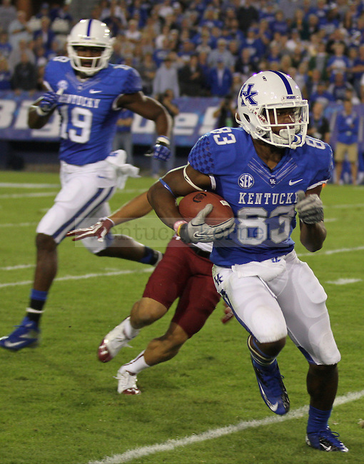 University of Kentucky freshman, DeMarcus Sweat, avoids a USC defenseman and turns the ball upfield in Lexington, Ky., on Saturday, September, 29, 2012. Photo by James Holt | Staff