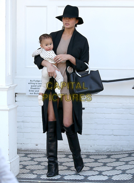 WEST HOLLYWOOD, CA - JANUARY 16: Chrissy Teigen and daughter Luna seen leaving Au Fudge restaurant in West Hollywood, California on January 16, 2017. <br /> CAP/MPI/JM<br /> &copy;JM/MPI/Capital Pictures
