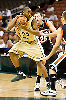 January 9, 2009:    Jacksonville forward Aric Brooks (22) grabs a rebound away from Mercer's Brian Mills (25) in  Atlantic Sun Conference action between the Jacksonville Dolphins and the Mercer Bears at Veterans Memorial Arena in Jacksonville, Florida.  Jacksonville defeated Mercer 80-59.