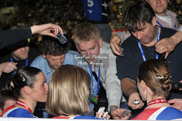 Wendy Houvenaghel (right), Joanna Rowsell and Sarah Storey (left) are interviewed by the press after receiving their gold medals. Womens Team Pursuit. UCI Track World Cup. Manchester Velodrome. 18/02/2011. MANDATORY CREDIT Sportinpictures/Garry Bowden