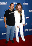 "LOS ANGELES, CA. - January 21: Actor Peter Jacobson and Producer Katie Jacobson arrive at the ""House"" 100th episode party and NAMI charity celebration held at STK on January 21st, 2009 in Los Angeles, California."