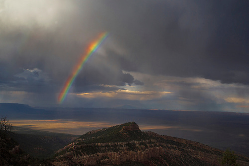 A rainbow appears during a monsoon at Marble Canyon, Arizona
