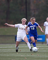 Hofstra University midfielder Tiffany Yovino (18) brings the ball forward as Boston College midfielder Julia Bouchelle (12) pressures. Boston College defeated Hofstra University, 3-1, in second round NCAA tournament match at Newton Soccer Field, Newton, MA.