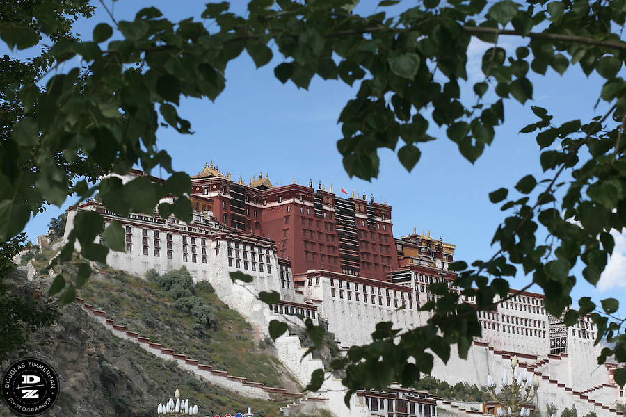 The Potala Palace in Lhasa, Tibet is the former residence of the Dalai Lama and is considered a revered religious structure in Tibet.  Photograph by Douglas ZImmerman