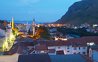 View over the city at sunset. Mosque minarets. Roof tops rooftops. Historic town of Mostar. Federation Bosne i Hercegovine. Bosnia Herzegovina, Europe.