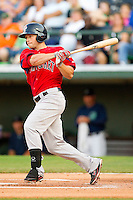 Daniel Nava #33 of the Pawtucket Red Sox follows through on his swing against the Charlotte Knights at Knights Stadium on August 11, 2011 in Fort Mill, South Carolina.  The Red Sox defeated the Knights 3-2.   (Brian Westerholt / Four Seam Images)