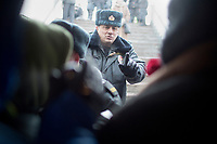 Police hold back people trying to enter Lubyanka Square for an unsanctioned anti-Putin demonstration in Moscow, Russia.  Police arrested a number of protesters and opposition leaders.