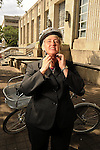 Mayor Annise Parker puts on a helmet before riding one of the Houston B-cycle bikes outside City Hall Monday April 30,2012. (Dave Rossman Photo)