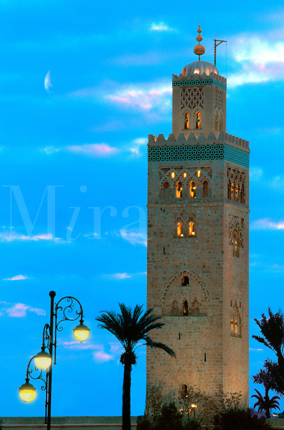 Minarette at dusk with streetlamps, Morocco