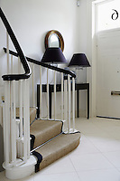 A curved contemporary staircase graces the entrance hall to this Georgian town house