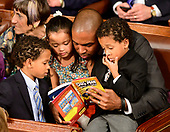 United States Representative Antonio Delgado (Democrat of New York) reads to his children from his seat as the 116th Congress convenes for its opening session in the US House Chamber of the US Capitol in Washington, DC on Thursday, January 3, 2019.<br /> Credit: Ron Sachs / CNP<br /> (RESTRICTION: NO New York or New Jersey Newspapers or newspapers within a 75 mile radius of New York City)