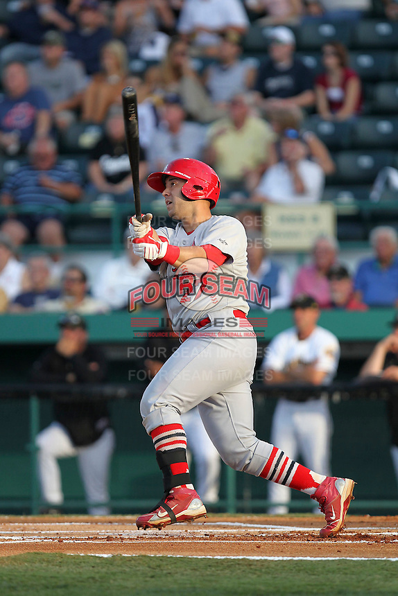 April 29, 2010 Catcher Tony Cruz of the Palm Beach Cardinals, Florida State League Class-A affiliate of the St.Louis Cardinals, Hits a 3 run home run during a game at McKenhnie Field in Bradenton Fl. Photo by: Mark LoMoglio/Four Seam Images