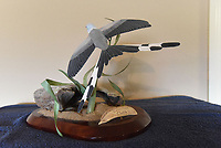 NWA Democrat-Gazette/FLIP PUTTHOFF<br />The unique tail of s scissor-tail flycatcher stands out Aug. 11 2017 in this carving by Wolfe.