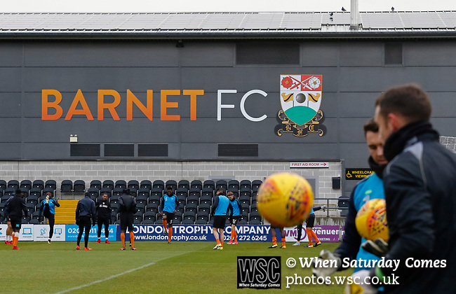 Barnet 2 Morecambe 0, 16/12/2017. The Hive, League Two. Barnet players warming up in front of a club badge on the East Stand. Photo by Paul Thompson.