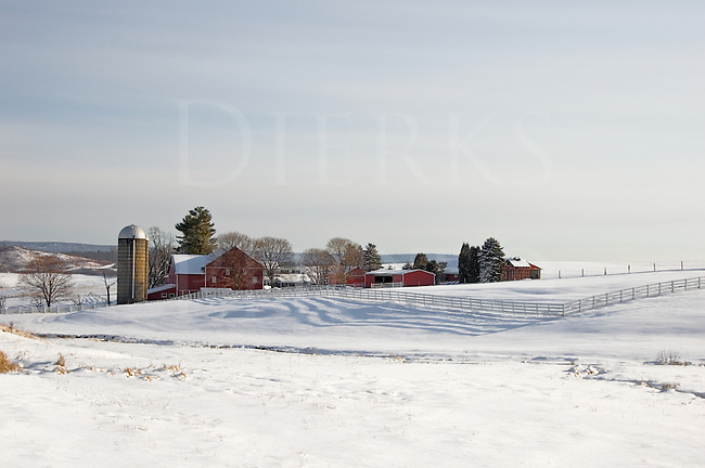 A dairy farm lays peacefully in snowy lands near Warriors Mark, Pennsylvania, Centre County, PA.