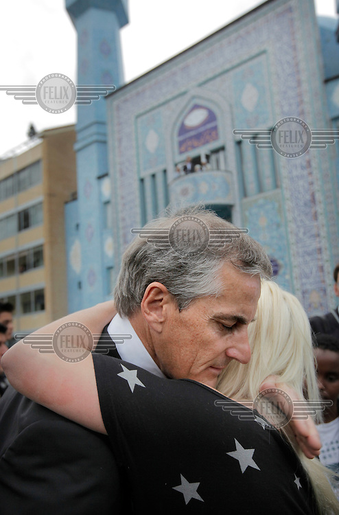 (Oslo July 26, 2011)  Foreign Minister Jonas Gahr Støre is embraced by a woman following a visit to the mosque World Islamic Mission in Oslo...A large vehicle bomb was detonated near the offices of Norwegian Prime Minister Jens Stoltenberg on 22 July 2011. .Another terrorist attack took place shortly afterwards, where a man killed 68 people, mainly children and youths attending a political camp at Utøya island. ..Anders Behring Breivik was arrested on the island and has admitted to carrying out both attacks..(photo:Fredrik Naumann/Felix Features)