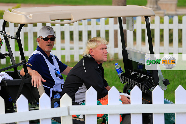 John Daly (USA) and caddy wait to tee off the 10th tee during Wednesday's Pro-Am of the 2013 BMW Masters held at Lake Malaren Golf Club, Shanghai, China. 23rd October 2013.<br /> Picture: Eoin Clarke/www.golffile.ie