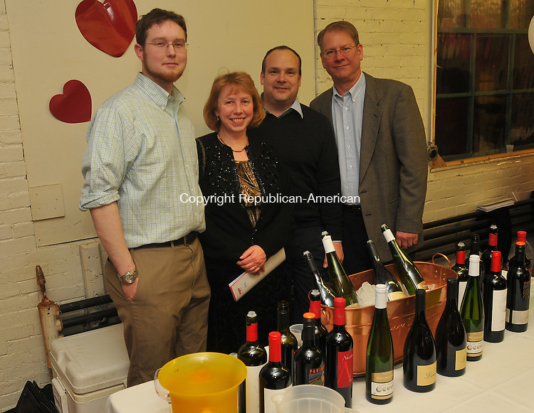 WINSTED, CT- 05 February 2010 - 020510IP13- (l to r) Reid Gibson of Ledgebrook Spirit Shop, Terry Simmins, a customer, Chris Battista and Neal Knofla of Ledgebrook Spirit Shop, attended The Friends of Main Street's fourth annual wine tasting and chocolate extravaganza called Bubbles and Truffles at Whiting Mills in Winsted on Friday. There were wine, beer, chocolate and appetizer tables for sampling. Proceeds from the fundraiser will benefit the town's downtown revitalization project.<br /> Irena Pastorello Republican-American
