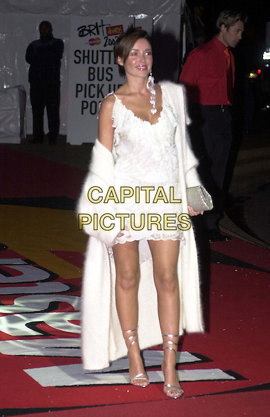 DANNI MINOGUE  .Arrivals for the Brit Awards at Earls Court .Dani, white wool coat, lace minidress, strappy heels, one earring, full length, full-length.*RAW SCAN - photo will be adjusted for publication*.www.capitalpictures.com.sales@capitalpictures.com.© Capital Pictures