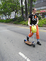 "Michelle walking her Go-Ped Know-Ped kick scooter during the June 2013 CicLAvia.  This was at the end of the route (6010 Wilshire Blvd.), where they had a 1/4 mile ""dismount zone"" that was for walking only."