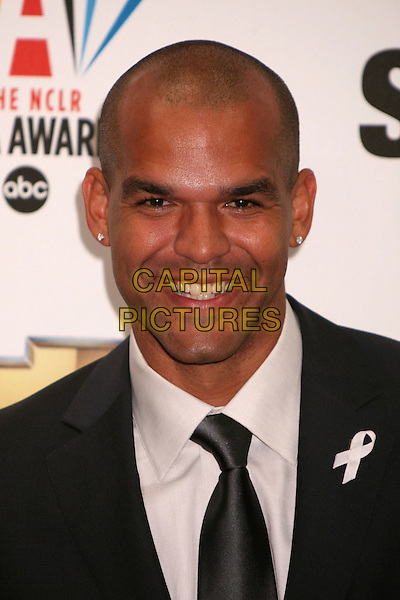 AMAURY NOLASCO.2007 NCLR ALMA Awards at the Pasadena Civic Center, Pasadena, California, USA..June 1st, 2007.headshot portrait diamond studs earrings white ribbon .CAP/ADM/BP.©Byron Purvis/AdMedia/Capital Pictures