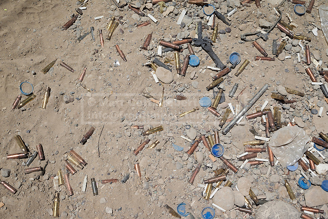 30/06/2014. Khanaqin, Iraq. Cigarette butts, water bottle lids and empty rifle and machine gun cartridges litter the ground at a Kurdish peshmerga base in Jalawla, Iraq. Counted by Kurds as part of their homeland, fighting in the town of Jalawla now consists of occasional skirmishes and exchanges of fire between snipers and heavy machine guns on both sides.<br /> <br /> The peshmerga, roughly translated as those who fight, is at present engaged in fighting ISIS all along the borders of the relatively safe semi-automatous province of Iraqi-Kurdistan. Though a well organised and experienced fighting force they are currently facing ISIS insurgents armed with superior armament taken from the Iraqi Army after they retreated on several fronts. &copy; Matt Cetti-Roberts