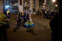 Police escort an OccupyBoston volunteer medic after police removed demonstrators from their second encampment at Rose F. Kennedy Greenway a block from Dewey Square, in downtown Boston, Massachusetts, USA.  The police and city officials warned protesters that they would be forceably removed from the site by midnight.  At about 1:30am police moved into the park, arrested approximately 100 protesters, and cleared the park of all tents and other protest materials.  The protesters are part of OccupyBoston, which is part of the OccupyWallStreet movement, expressing discontent with the socioeconomic situation of the 99% of the US population who are not wealthy.  Protestors have been camping in Dewey Square since Sept. 30, 2011. Gradually, larger organizations, including major labor unions, have expressed their support for the OccupyBoston effort.