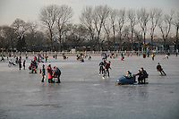 Beijingers on the frozen Houhai lake.
