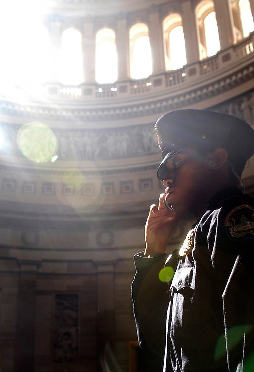 U.S. Capitol Police officer David Eley stands guard before the start of the Congressional Medal ceremony for the late baseball star Jackie Robinson in the rotunda of the Capitol.