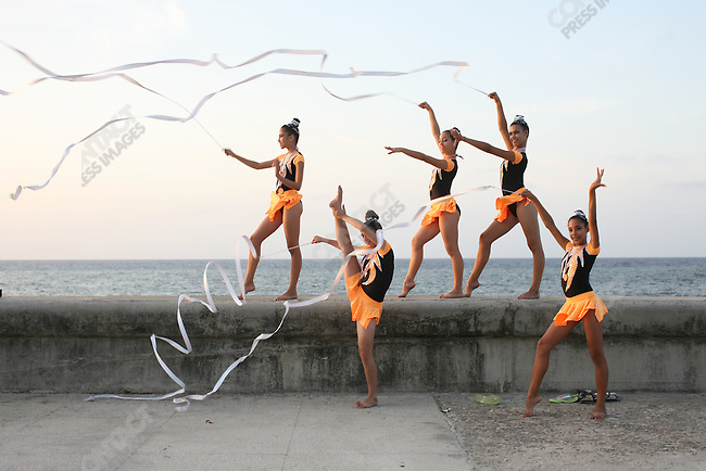 ©2008 David Burnett / Contact Press Images..July 11 2008..Havana, Cuba.The Malecon at sunset: a group of 12/13 year old girls from the country side who have won Bronze Medals in a Rhythmic Gymnastics competition in Havana