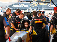Mar 17, 2018; Gainesville, FL, USA; Crew members surround NHRA top fuel driver Richie Crampton as they prepare to warm up the car in the pits during qualifying for the Gatornationals at Gainesville Raceway. Mandatory Credit: Mark J. Rebilas-USA TODAY Sports