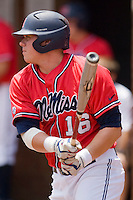 Matt Smith #16 of the Ole Miss Rebels follows through on his swing against the St. John's Red Storm at the Charlottesville Regional of the 2010 College World Series at Davenport Field on June 6, 2010, in Charlottesville, Virginia.  The Red Storm defeated the Rebels 20-16.  Photo by Brian Westerholt / Four Seam Images