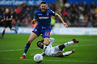 Craig Noone of Bolton Wanderers is fouled by Nathan Dyer of Swansea City during the Sky Bet Championship match between Swansea City and Bolton Wanderers at the Liberty Stadium in Swansea, Wales, UK.  Saturday 02 March, 2019