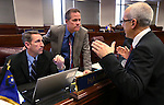 Nevada Senate Republicans Scott Hammond and Mark Hutchison, left, talk with Senate Majority Leader Mo Denis, D-Las Vegas, on the Senate floor at the Legislative Building in Carson City, Nev., on Friday, April 19, 2013. .Photo by Cathleen Allison