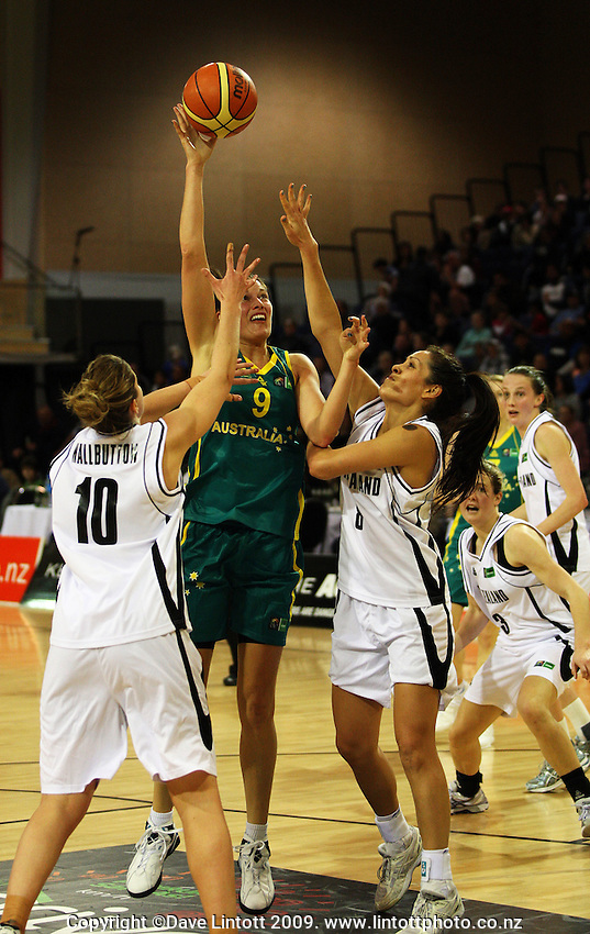 Opals forward Hollie Grima shoots under pressure from Lisa Wallbutton and Natalie Purcell during the International women's basketball match between NZ Tall Ferns and Australian Opals at Te Rauparaha Stadium, Porirua, Wellington, New Zealand on Monday 31 August 2009. Photo: Dave Lintott / lintottphoto.co.nz