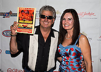 Aug. 29, 2013; Avon, IN, USA: NHRA NHRA funny car driver John Force (left) and wife Laurie Force on the red carpet prior to the premiere of Snake & Mongoo$e at the Regal Shiloh Crossing Stadium 18. Mandatory Credit: Mark J. Rebilas-