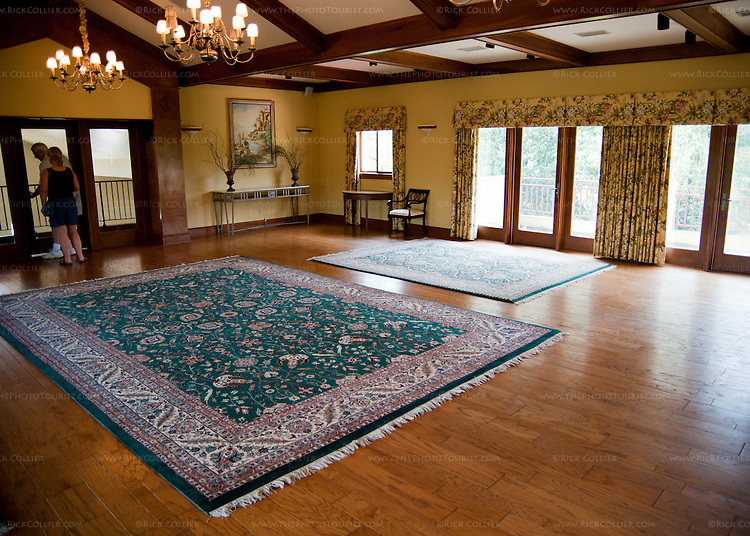 The function / reception room upstairs at White Hall Vineyards is beautifully decorated with hardwood floors and balconies and windows on both sides, offering spectacular views of surrounding hills and vineyards.  A door at the back opens to a balcony overlooking the winery's workspace and fermenting tanks.