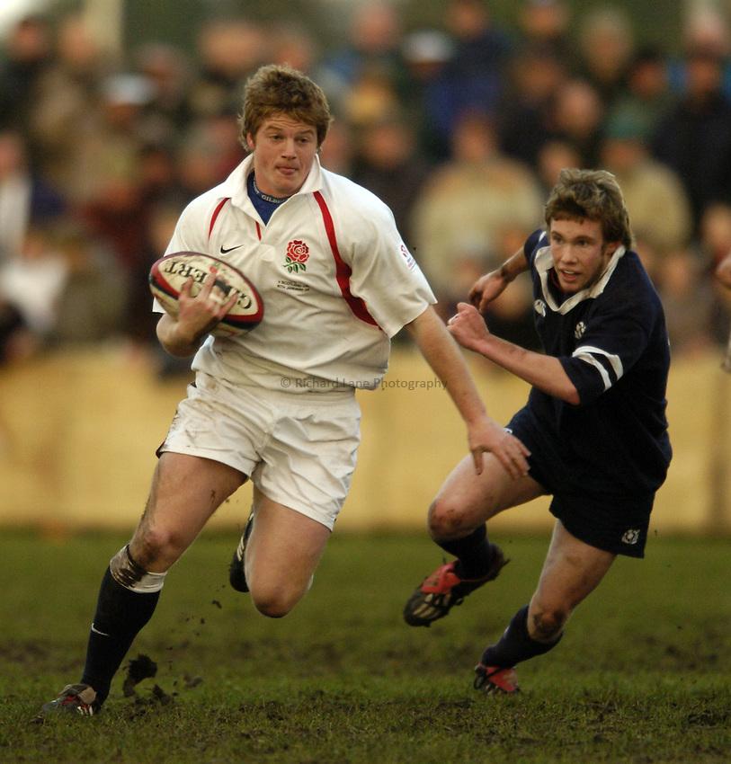 Photo. Jed Wee..England U19 v Scotland U19, U19 Six Nations Championship, Woodlands Stadium, Lytham St Annes. 16/01/2004..England's Tom Gregory (L) with Scotland's Stephen Biggart.