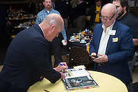 "Former Major League Baseball pitcher Jim Abbott autographs a book for one of the guests at the Wake Forest Baseball ""First Pitch"" Dinner on February 9, 2017 in Winston-Salem, North Carolina.  (Brian Westerholt/Four Seam Images)"