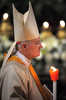 Cardinal Marc Ouelett .Pope Francis, holds a candle during the Easter vigil mass in Saint Peter's Basilica, in the Vatican.,30 March 2013
