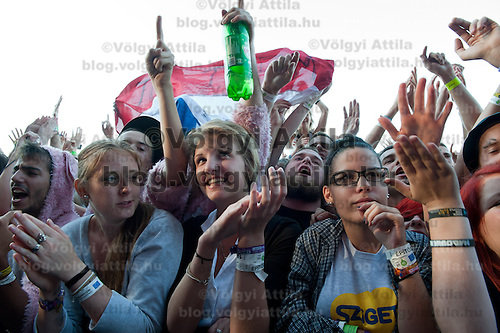 Participants cheer in the audience during a concert on Sziget festival held in Budapest, Hungary on August 10, 2011. ATTILA VOLGYI