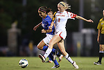 20 September 2012: Duke's Gilda Doria (left) and Maryland's Ashley Spivey (8). The University of Maryland Terrapins played the Duke University Blue Devils to a 2-2 tie after overtime at Koskinen Stadium in Durham, North Carolina in a 2012 NCAA Division I Women's Soccer game.