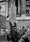 Protesting student holds a placard of Ho Chi Minh, President of the Democratic Republic of Vietnam (North Vietnam), anti-Vietnam war demonstration march from Trafalgar Sq to Grosvenor Sq Sunday 17th March 1968.  I was told the headband was a Vietnamese sign of mourning for dead children.
