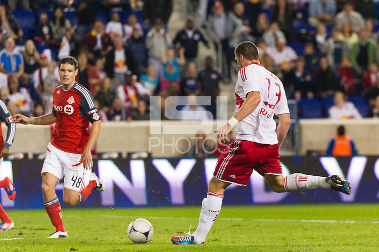 Kenny Cooper (33) of the New York Red Bulls shoots and scores during the first half against Toronto FC. The New York Red Bulls defeated Toronto FC 4-1 during a Major League Soccer (MLS) match at Red Bull Arena in Harrison, NJ, on September 29, 2012.