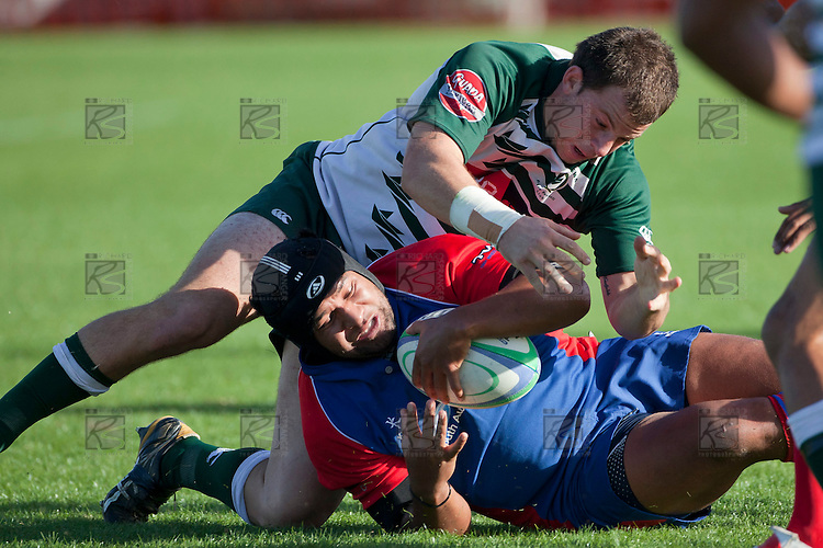 Mark Selwyn arrives to try and secure the tackle ball as Robinson Avei goes to ground. Counties Manukau Premier Rugby game between Ardmore Marist  and Manurewa played at Bruce Pulman Park Papakura on May 14th 2011. Ardmore Marist won 48 - 10 after leading 29 - 3 at halftime.