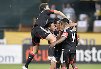 D.C. United defender Brandon McDonald (4) celebrates his score with teammates Marcelo Saragosa,Dejan Jakovic and Andy Najar. D.C. United defeated The Chicago Fire 4-2 at RFK Stadium, Wednesday August 22, 2012.