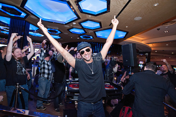LAS VEGAS, NV - November 15, 2015: ***HOUSE COVERAGE*** Tom Morello pictured at DJ Set by DJ Comandante, Tom Morello of Rage Against The Machine/Audioslave & Carl Restivo at The Center Bar at Hard Rock Hotel Casino in Las vegas, NV on November 14, 2015. Credit: Erik Kabik Photography/ MediaPunch