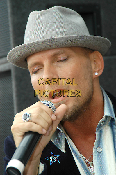 "MATT GOSS.Performs a live accoustic set and signs copies of his new single ""Fly"" in HMV, Leeds,.July 22nd, 2004..portrait headshot hat earring silver necklace ring jewellery microphone singing live music gig .Ref: HT.www.capitalpictures.com.sales@capitalpictures.com.©Capital Pictures."